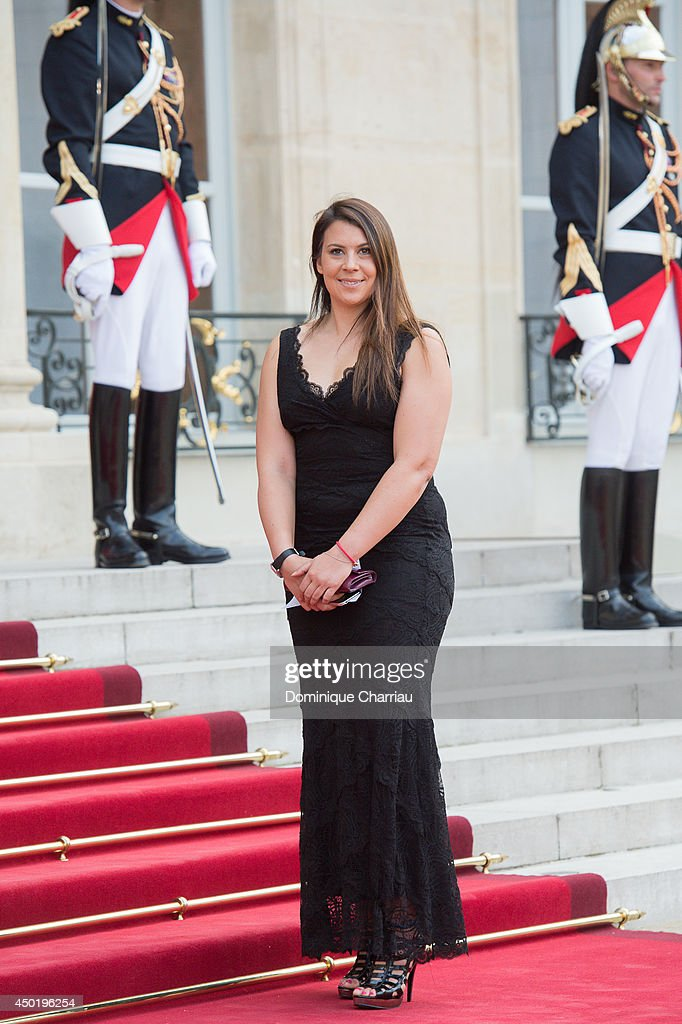 French tennis women <a gi-track='captionPersonalityLinkClicked' href=/galleries/search?phrase=Marion+Bartoli&family=editorial&specificpeople=227896 ng-click='$event.stopPropagation()'>Marion Bartoli</a> arrives at the Elysee Palace for a State dinner in honor of Queen Elizabeth II, hosted by French President Francois Hollande as part of a three days State visit of Queen Elizabeth II after the 70th Anniversary Of The D-Day on June 6, 2014 in Paris, France.