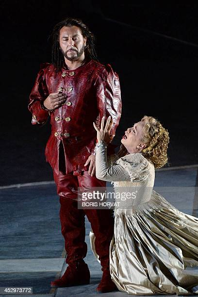 French tenor Roberto Alagna and Albanian soprano Inva Mula as Desdemona perform performs during the rehearsal of the opera 'Otello' by Italian...