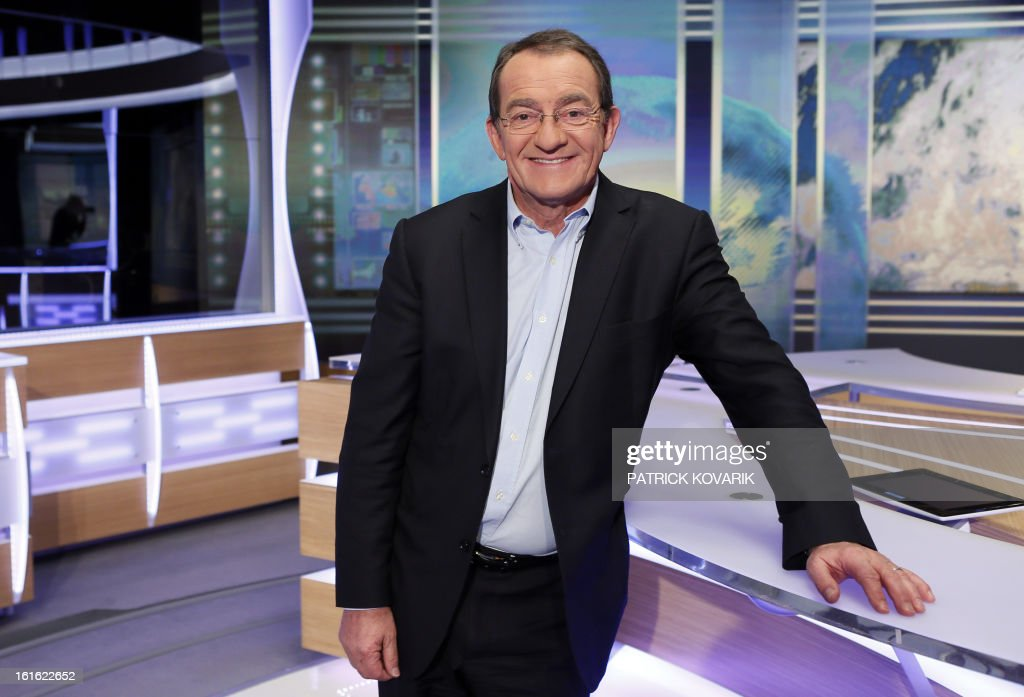 French TF1 Television national channel anchorman Jean-Pierre Pernaut poses on his studio set on February 13, 2013 in Paris.