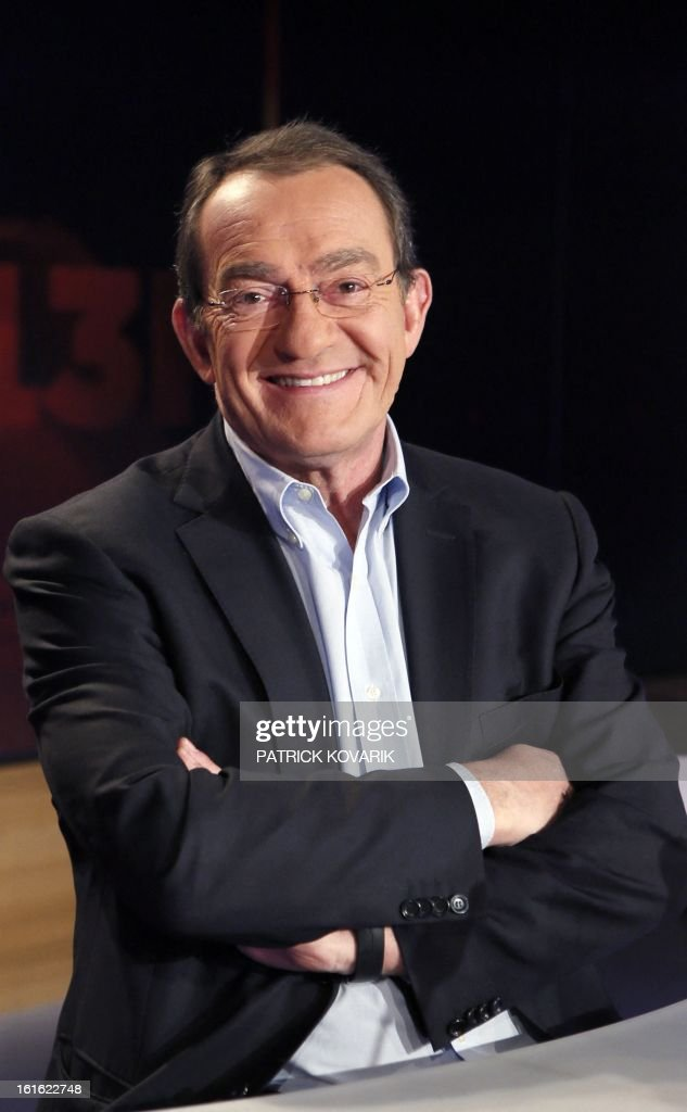 French TF1 Television national channel anchorman Jean-Pierre Pernaut poses on his studio set on February 13, 2013 in Paris. AFP PHOTO / PATRICK KOVARIK