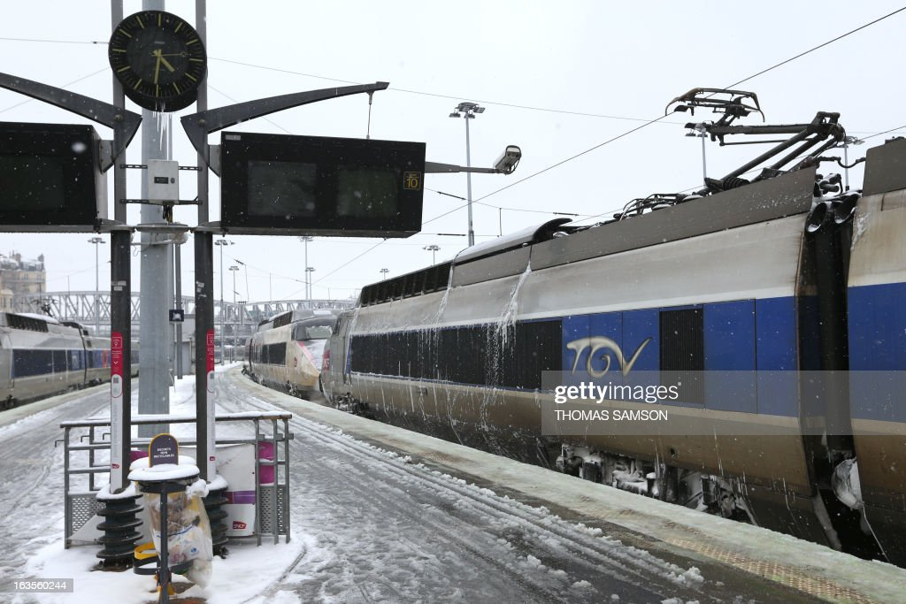 French TGV high-speed trains are blocked in the gare du Nord railway station in Paris as high-speed lines are suspended due to heavy snow falls. More than 68,000 homes were without electricity in France and hundreds of people were trapped in their cars. Road, train and air traffic are disrupted in many areas. Twenty-six regions in northwest and northern France were put on orange alert because of heavy snowfalls, which Meteo France said were 'remarkable for the season because of the expected quantity and length of time'.