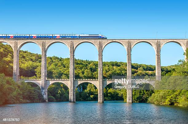 French TGV train on stone viaduct in Rhone-Alpes France