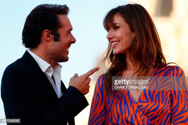 French theatre director actor and comedian Nicolas Bedos and French actress Doria Tillier speak together as they pose on the red carpet on June 17...