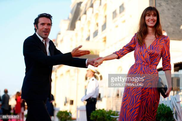 French theatre director actor and comedian Nicolas Bedos and French actress Doria Tillier pose on the red carpet on June 17 2017 during the Cabourg...