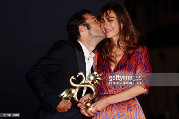 French theatre director actor and comedian Nicolas Bedos kisses French actress Doria Tillier after she received the revelation price award on June 17...