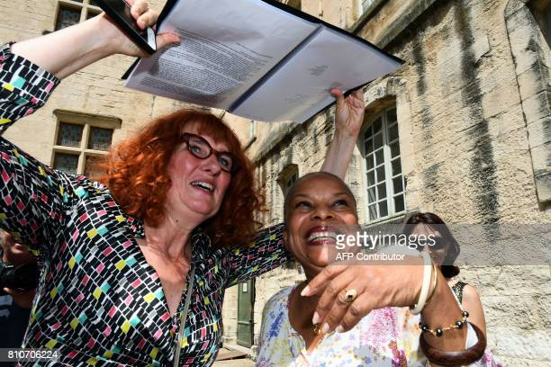 French theatre director AnneLaure Liegeois and former French Justice Minister Christiane Taubira protect themselves from the sun with a notebook upon...