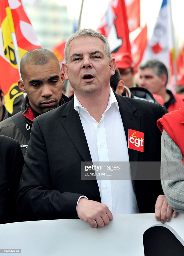 French Thierry Le Paon, CGT labour union next General Secretary, shouts slogans as he walks ahead, on March 5, 2013 in Lille, northern France, of a demonstration called by CGT and FO unions to protest against last January 11's interbranch agreement between several workers' unions and the French employers' association Medef, on employment's safeguard. The government will discuss the agreement in the March 6 cabinet meeting. Le Paon was designated in November 2012 to succeed to Bernard Thibault in charge of the union since 1999.