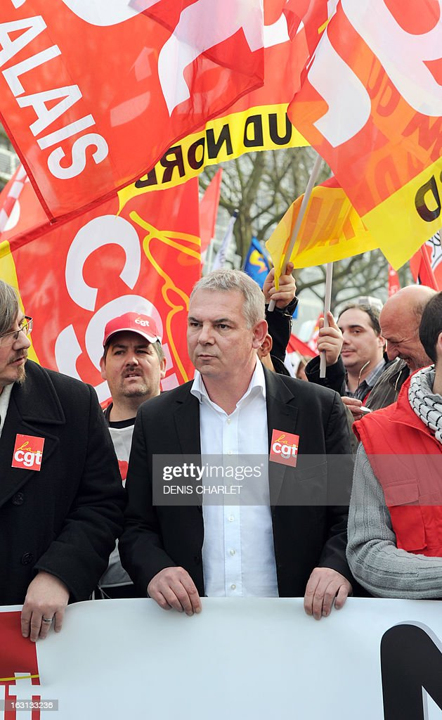 French Thierry Le Paon, CGT labour union next General Secretary, walks ahead, on March 5, 2013 in Lille, northern France, of a demonstration called by CGT and FO unions to protest against last January 11's interbranch agreement between several workers' unions and the French employers' association Medef, on employment's safeguard. The government will discuss the agreement in the March 6 cabinet meeting. Le Paon was designated in November 2012 to succeed to Bernard Thibault in charge of the union since 1999. AFP PHOTO / DENIS CHARLET