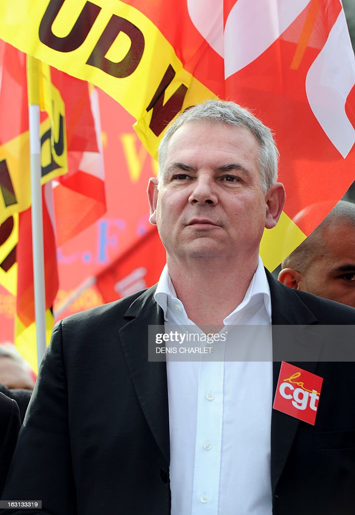 French Thierry Le Paon, CGT labour union next General Secretary, walks ahead, on March 5, 2013 in Lille, northern France, of a demonstration called by CGT and FO unions to protest against last January 11's interbranch agreement between several workers' unions and the French employers' association Medef, on employment's safeguard. The government will discuss the agreement in the March 6 cabinet meeting. Le Paon was designated in November 2012 to succeed to Bernard Thibault in charge of the union since 1999.