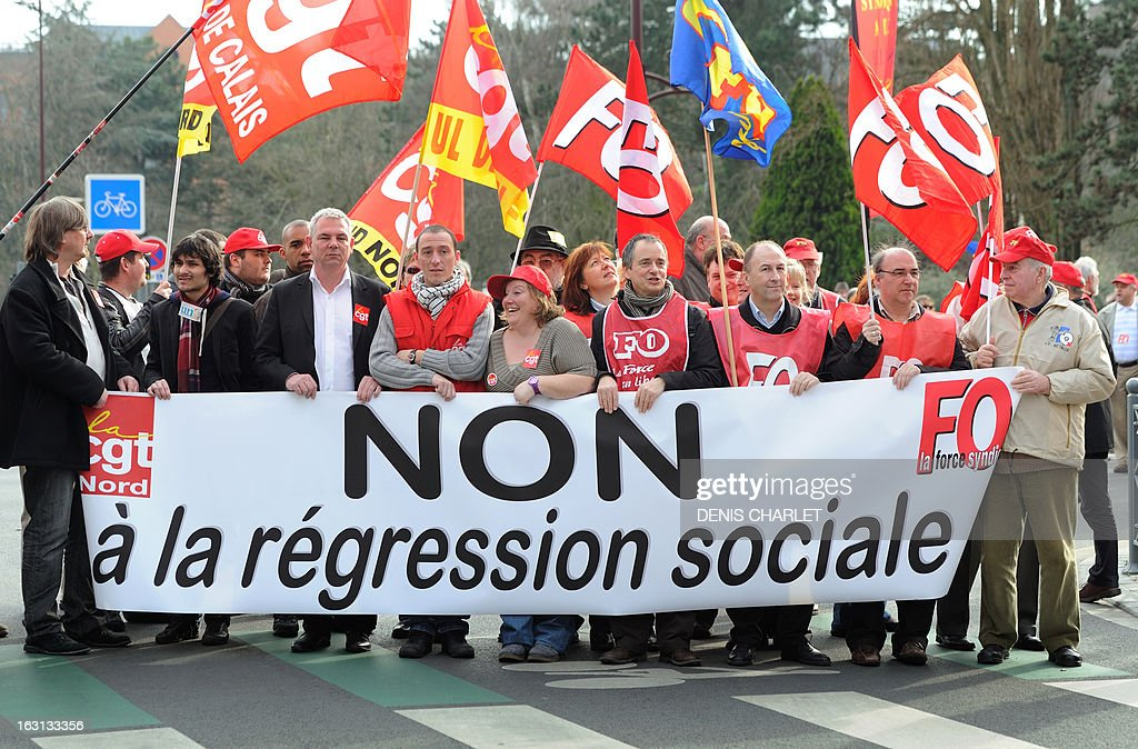French Thierry Le Paon (7thR, first row), CGT labour union next General Secretary, walks ahead, on March 5, 2013 in Lille, northern France, of a demonstration called by CGT and FO unions to protest against last January 11's interbranch agreement between several workers' unions and the French employers' association Medef, on employment's safeguard. The government will discuss the agreement in the March 6 cabinet meeting. Le Paon was designated in November 2012 to succeed to Bernard Thibault in charge of the union since 1999.