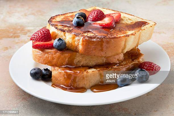 French Toast With Fruit and Syrup on a Marble Countertop.