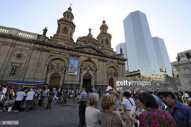 French tourists are seen in front of the Cathedral of Santiago at the Plaza de Armas square closed due to the recent quake on March 6 2010 The...