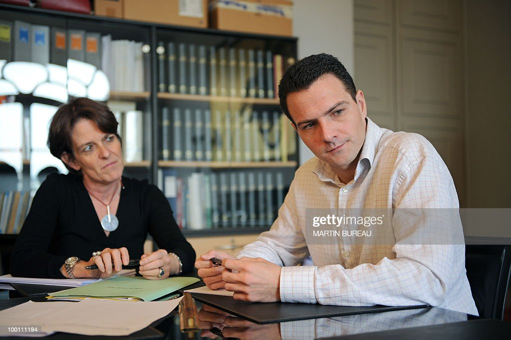 French trader Jerome Kerviel (R) poses with his lawyer Elisabeth Meyer, February 5, 2008 during an exclusive interview with AFP at the lawyers' office in Paris. Kerviel was questioned today by judges investigating his role in the multi-billion euro rogue trade scandal at Societe Generale, judicial officials said. The French bank accuses 31-year-old Kerviel of causing it losses of 4.8 billion euros (7.1 billion dollars), by placing more than 50 billion euros in unauthorised futures trades, discovered on January 20.