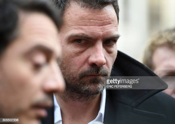 TOPSHOT French trader Jerome Kerviel stands next to his lawyer David Koubbi who answers to journalists' questions as Jerome Kerviel arrives in the...
