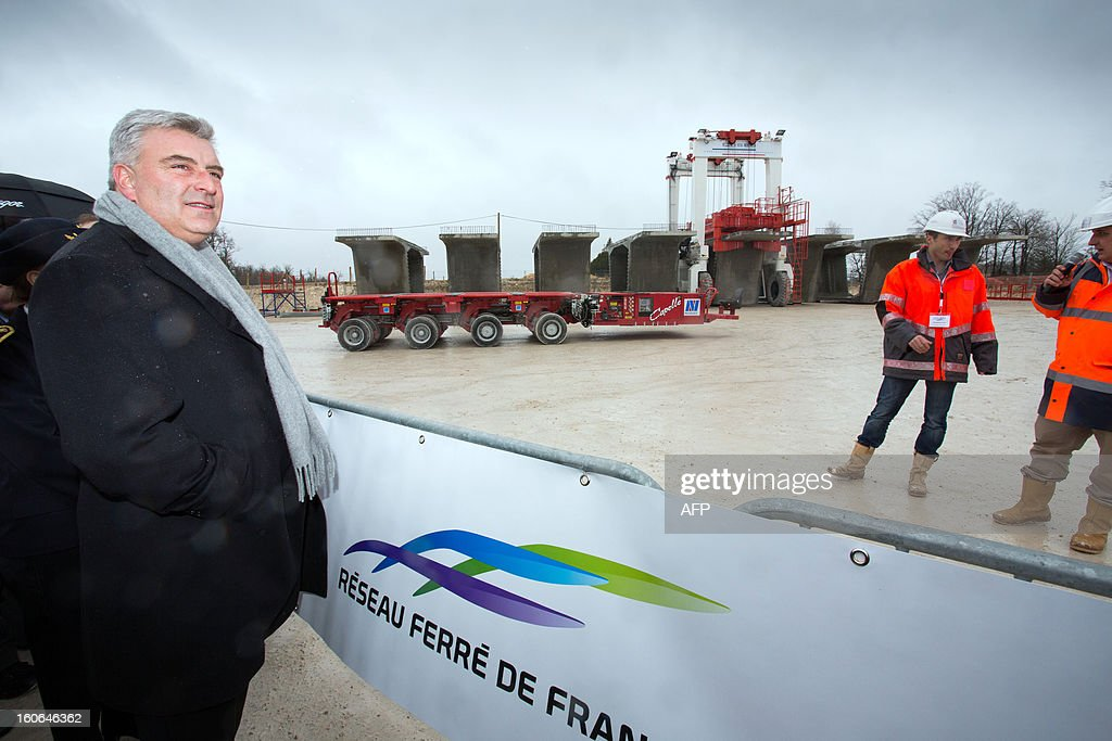 French Transports minister Frederic Cuvillier attends the installation of the first voussoirs of a bridge as he visits a building site of the Tours-Bordeaux LGV high speed train line on February 4, 2013 in Roullet-Saint-Estephe.