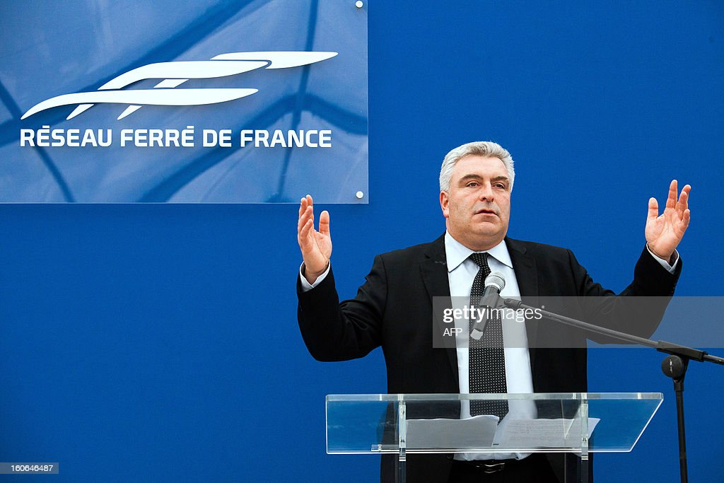 French Transports minister Frederic Cuvillier delivers a speech, on February 4, 2013 in Roullet-Saint-Estephe, after attending the installation of the first voussoirs of the first bridge of the Tours-Bordeaux LGV high speed train line. AFP PHOTO PIERRE DUFFOUR