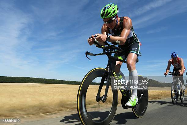 French triathlete Ludovic Chorgnon takes part in the 180km ride of the Ironman triathlon in Vendome on August 10 2015 Ludovic Chorgnon competed today...