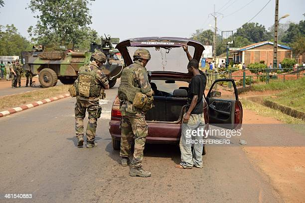 French troops from the Operation Sangaris forces search traffic looking for weapons on January 9 2014 in the fourth district of Bangui Central...