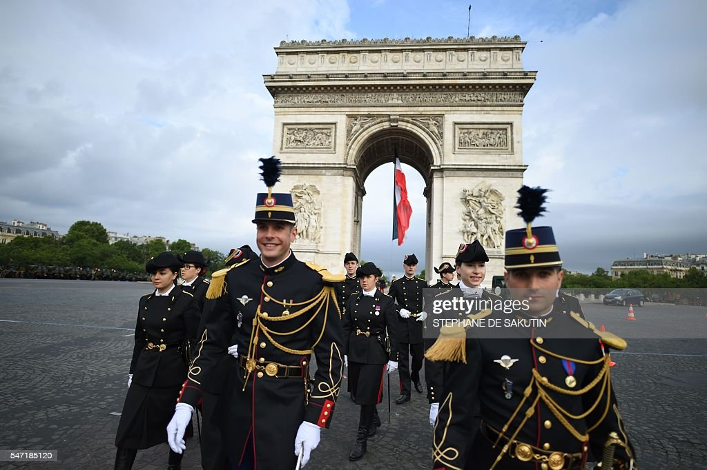 TOPSHOT French troops of the Ecole Polytechnique military school and the French Gendarmerie walk near the Arc de Triomphe in Paris before taking part...