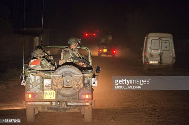 French troops of the Sangaris operation patrol the Boy Rabe district in Bangui on December 20 2013 More than 30 people including a Chadian...