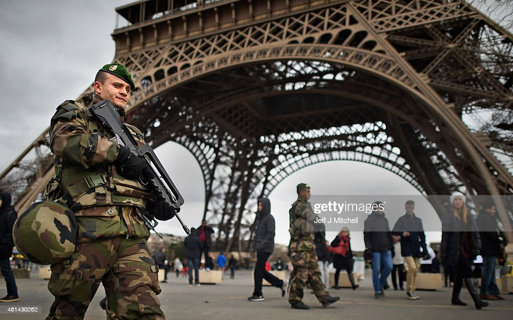 French troops patrol around the Eifel Tower on January 12 2015 in Paris France France is set to deploy 10000 troops to boost security following last...