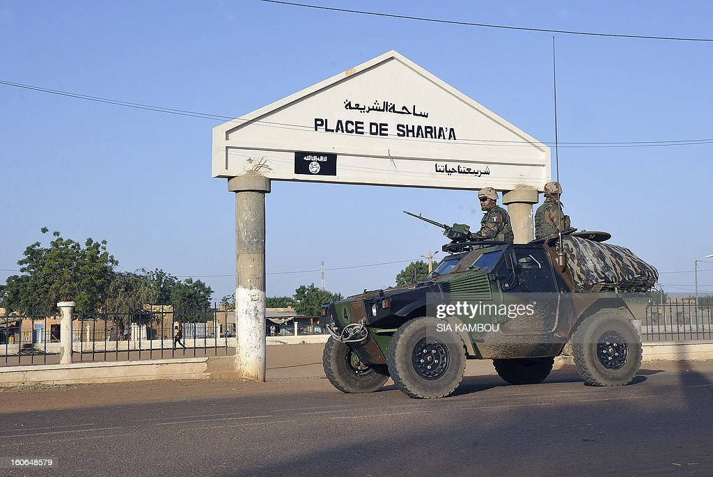 French troops patrol in Gao on February 4, 2013 . Schools reopened Monday in Gao in northern Mali after French and Malian troops moved in and armed Islamists who had held the town for seven months fled. AFP PHOTO / SIA KAMBOU