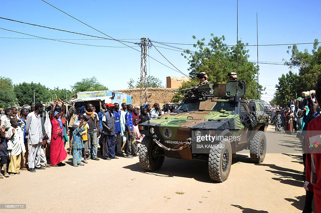 French troops patrol in the streets of Gao on February 3, 2013. France said it carried out major air strikes today near Kidal, the last bastion of armed extremists chased from Mali's desert north in a lightning French-led offensive. AFP PHOTO / SIA KAMBOU AFP PHOTO / SIA KAMBOU