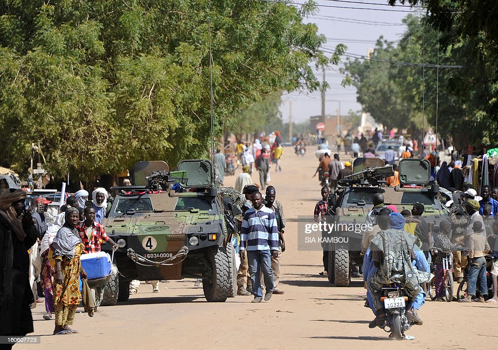 French troops patrol in the streets of Gao on February 3, 2013. France said it carried out major air strikes today near Kidal, the last bastion of armed extremists chased from Mali's desert north in a lightning French-led offensive.
