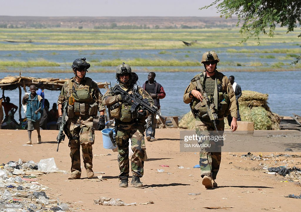 French troops patrol on January 30, 2013 along the Niger river in the northern city of Gao, a key Islamist stronghold until it was retaken on January 26 by French and Malian troops in a major boost to the French-led offensive against the Al Qaeda-linked rebels, who have been holding Mali's vast desert north since last April. French troops on January 30 entered Kidal, the last Islamist bastion in Mali's north after a whirlwind Paris-led offensive, as France urged peace talks to douse ethnic tensions targeting Arabs and Tuaregs.