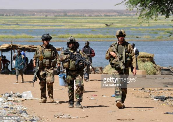 French troops patrol on January 30 2013 along the Niger river in the northern city of Gao a key Islamist stronghold until it was retaken on January...