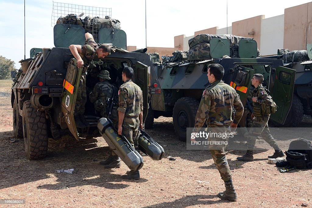 French troops prepare their Sagaie armoured all terrain vehicles from the 'Licorne' operation based in Abidjan (Ivory Coast) at the 101 military airbase near Bamako on January 15, 2013 to reinforce the 'Serval' operation, before their deployment in the north of Mali. France is using air and ground power in a joint offensive with Malian soldiers launched on January 11 against hardline Islamist groups controlling northern Mali.