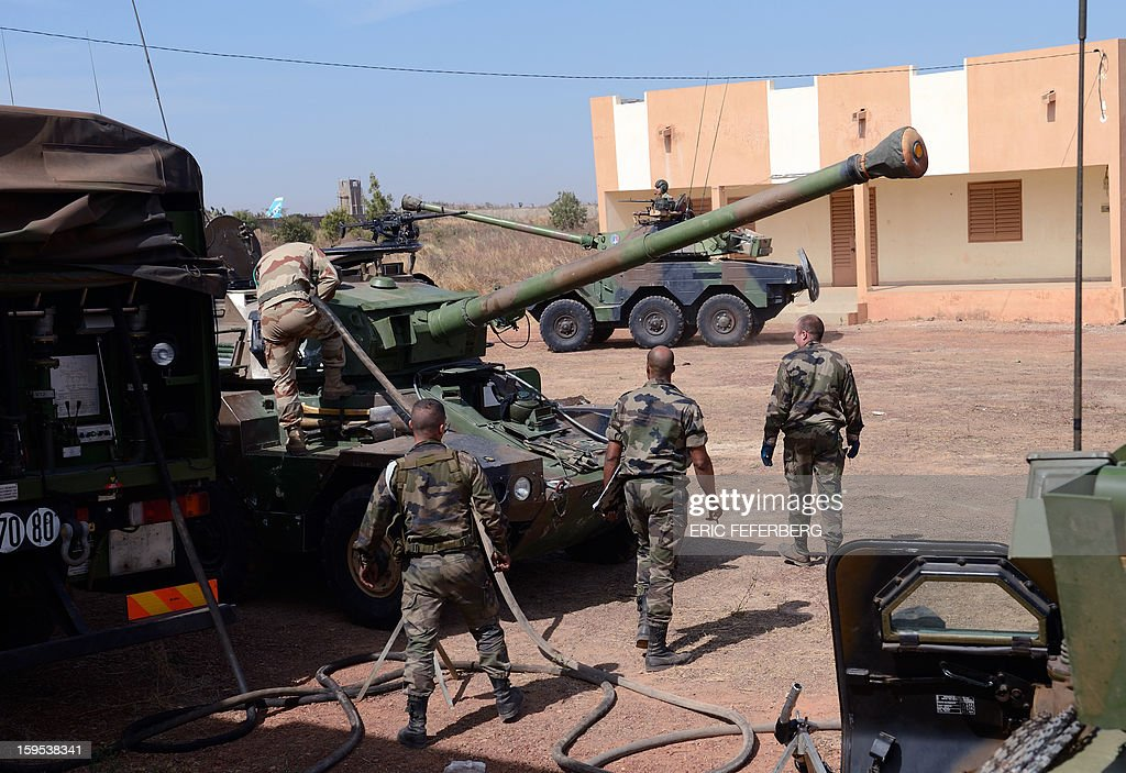 French troops prepare their Sagaie armoured all terrain vehicles from the 'Licorne' operation based in Abidjan (Ivory Coast) at the 101 military airbase near Bamako on January 15, 2013 to reinforce the 'Serval' operation, before their deployment in the north of Mali. France is using air and ground power in a joint offensive with Malian soldiers launched on January 11 against hardline Islamist groups controlling northern Mali. AFP PHOTO /ERIC FEFERBERG