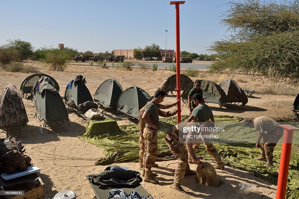 French troops set up a camp on January 30, 2013 at Timbuktu airport two days after freeing the northern Malian desert city. French troops on January 30 entered Kidal, the last Islamist bastion in Mali's north after a whirlwind Paris-led offensive, as France urged peace talks to douse ethnic tensions targeting Arabs and Tuaregs.