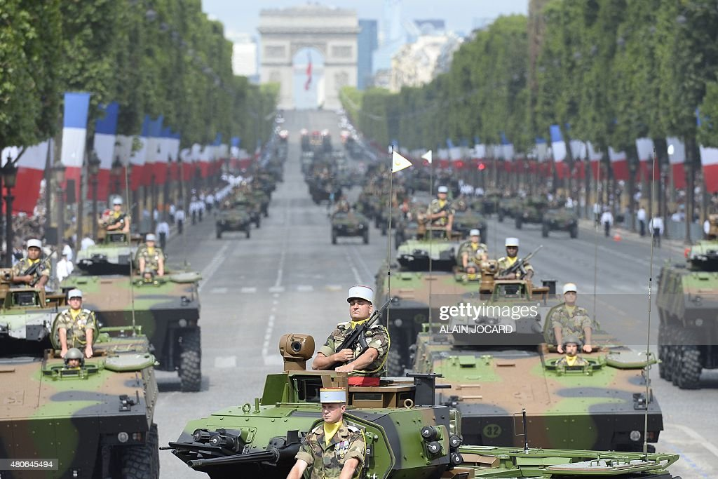 French troops with armoured vehicles for infantry combat take part in the annual Bastille Day military parade in Paris on July 14 2015 AFP PHOTO /...
