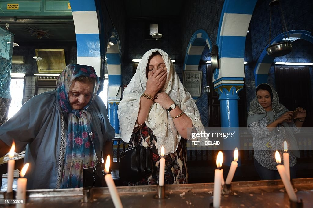 French Tunisian Jewish women pray at the Ghriba synagogue in the Tunisian resort island of Djerba during the annual Jewish pilgrimage on May 25, 2016. Pilgrims arrived at Tunisia's Ghriba synagogue, the oldest in Africa, expressing hope that this year would mark a turning point for the ritual despite a rise in Islamist unrest since the 2011 revolution. Djerba is home to one of the last Jewish communities in the Arab world. / AFP / FETHI