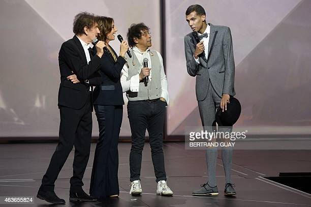 French TV host and master of ceremony Virginie Guilhaume speaks with Belgian singer Stromae and French singers Alain Souchon and Laurent Voulzy...