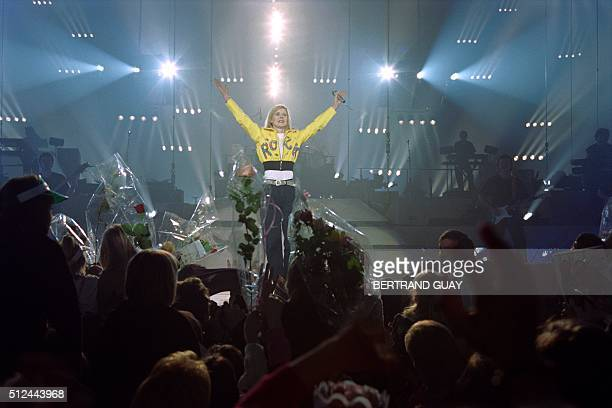 French TV host and singer Dorothée performs on January 19 1992 at the Bercy concert hall in Paris / AFP / Bertrand GUAY