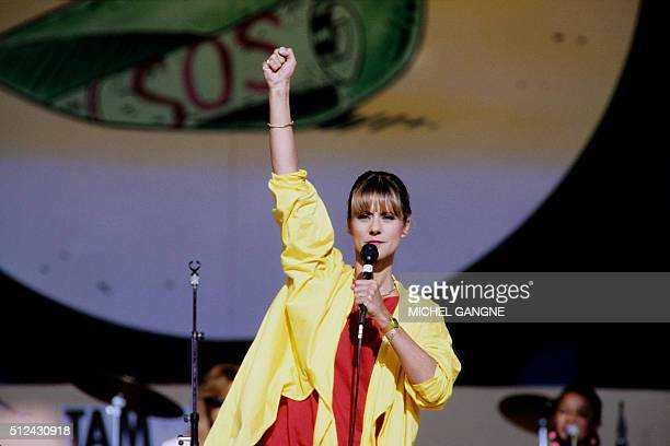 French TV host and singer Frederique Hoschede better known as Dorothée performs on October 13 1985 at La Courneuve near Paris during the charity...