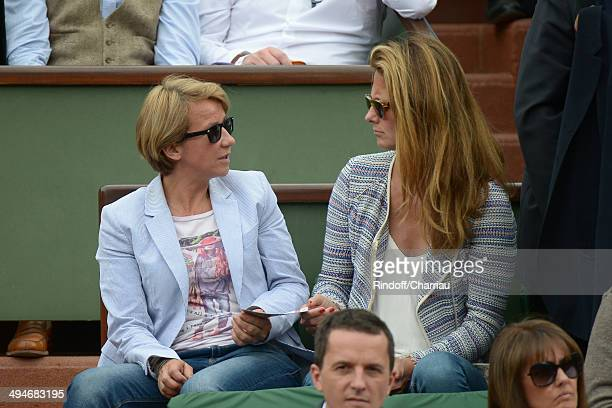 French TV host Ariane Massenet and guest attend the Roland Garros French Tennis Open 2014 Day 6 at Roland Garros on May 30 2014 in Paris France