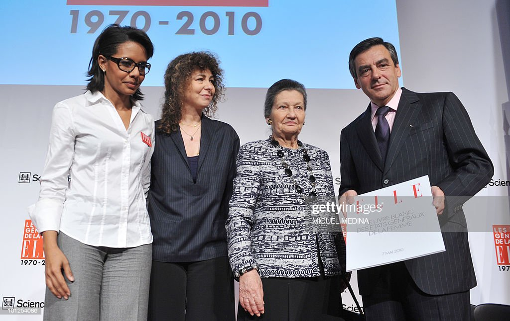 French TV host Audrey Pulvar, editor in chief of ELLE magazine Valerie Toranian, Academie Française member, former minister and European Parliament Chairwoman Simone Veil, and French Prime Minister Francois Fillon, pose on the last day of the Women's Forum at French Political Sciences Institute in Paris on May 07, 2010. The meeting that gathers business women, political leaders and artists is organized by French weekly magazine ELLE.