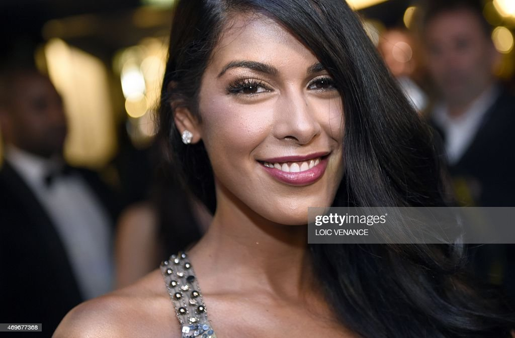 French tv host <a gi-track='captionPersonalityLinkClicked' href=/galleries/search?phrase=Ayem+Nour&family=editorial&specificpeople=8920076 ng-click='$event.stopPropagation()'>Ayem Nour</a> poses as she arrives for the 10th edition of the Globes de Cristal award ceremony (arts and culture) in Paris on April 13, 2015. AFP PHOTO / LOIC VENANCE