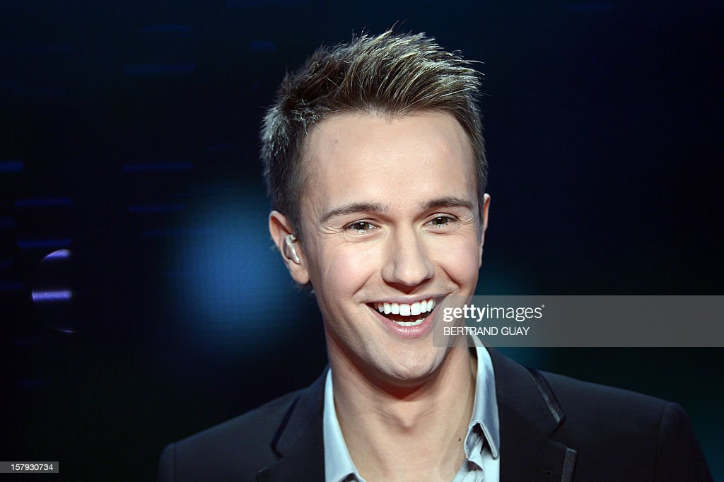 French TV host Cyril Feraud smiles during the 26th Telethon, France's biggest annual fund-raising event broadcast live on television during 30 hours, on December 7, 2012 in Saint-Denis, north of Paris.