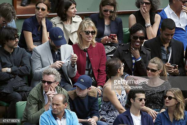 French TV host Denis Brogniart French actress Pauline Lefevre and French humorist Claudia Tagbo attend a match at the Roland Garros 2015 French...