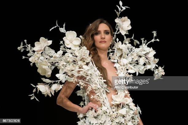 French tv host Ellen Batelaan presents a creation during the 23nd Chocolate Fair 2017 fashion show in Paris on October 27 2017 / AFP PHOTO / Thomas...