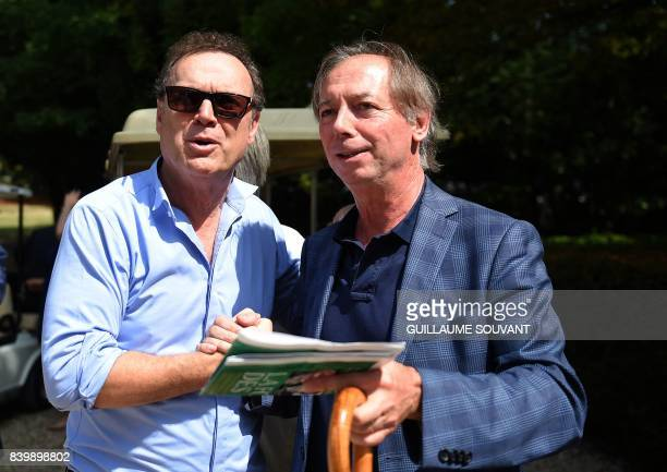 French tv host Julien Lepers and humorist Philippe Chevalier pose during the 22th La Foret Des Livres book fair on August 27 2017 in...