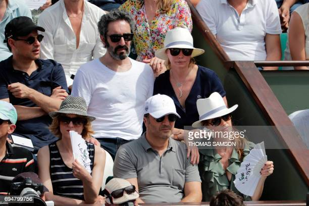 French TV host MarcOlivier Fogiel actress Emmanuelle Beart and her partner Frederic TV host Arthur and his partner Mareva Galanter attend the final...