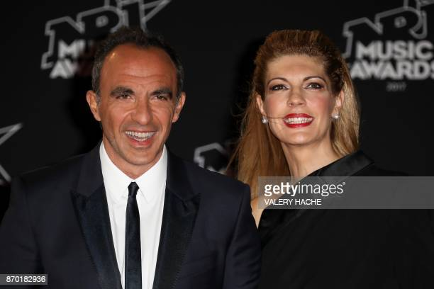 French TV host Nikos Aliagas and his wife Tina Grigoriou pose upon their arrival to attend the 19th NRJ Music Awards at the Palais des Festivals in...