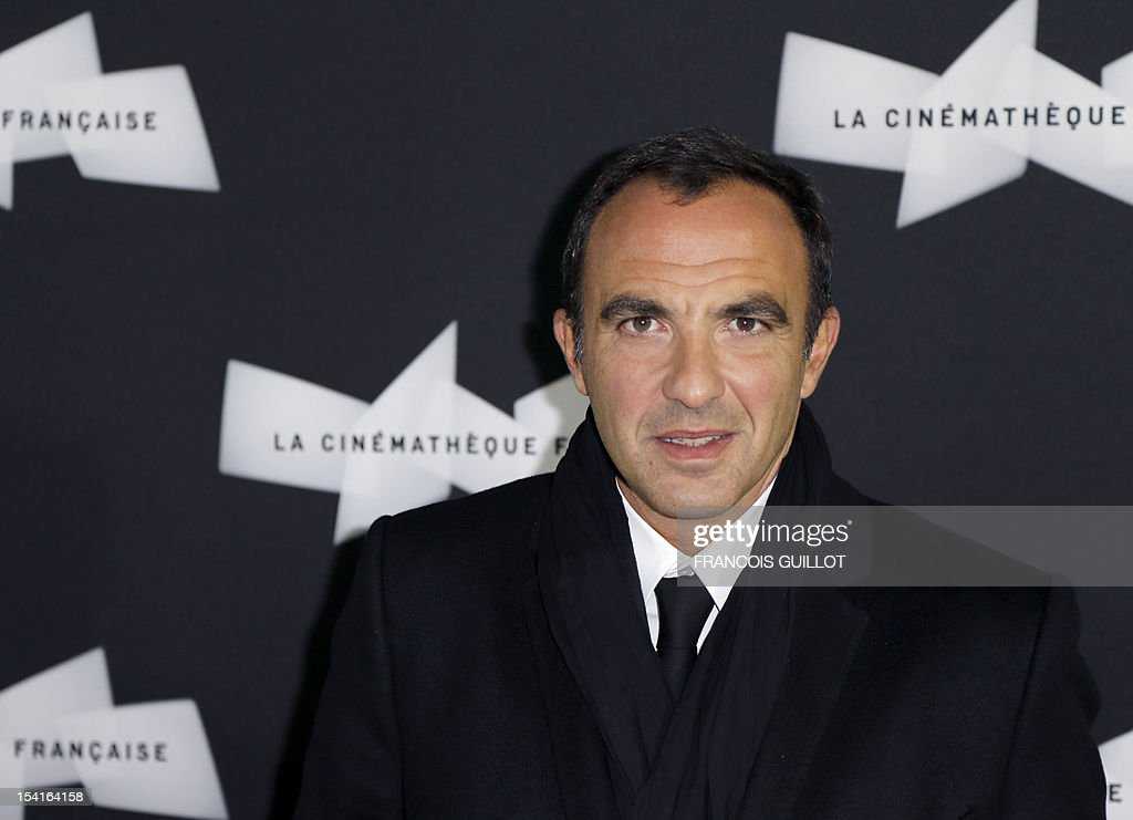French TV host Nikos Aliagas poses during a photocall prior to the premiere screening of the movie 'Amour', awarded the 2012 Cannes film festival Palme d'Or, on October 15, 2012 in Paris.