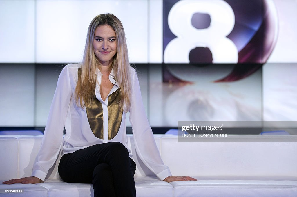 French TV host Olivia de Burhen is seen during the official launch of the French D8 TV channel flanked by the hosts of the channel on October 7, 2012 in Paris. D8 is the new name of Direct 8 that Canal + group bought to French Bollore group. Bachelot will host the program 'Le Grand 8' with Hapsatou Sy and journalists Elisabeth Bost, Audrey Pulvar and Laurence Ferrari.