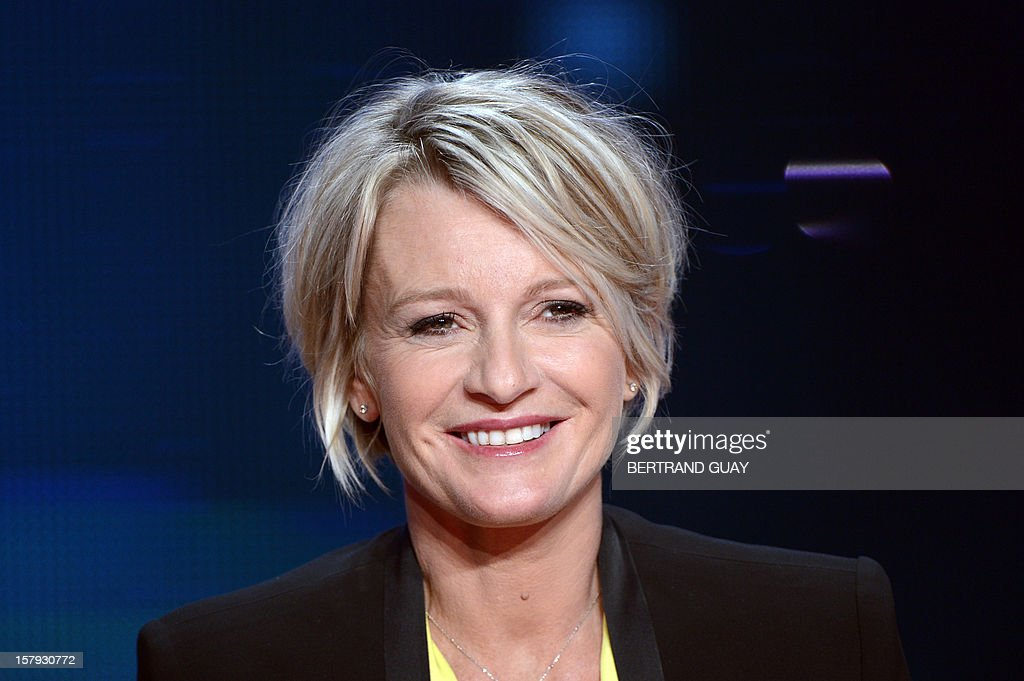 French TV host Sophie Davant smiles during the 26th Telethon, France's biggest annual fund-raising event broadcast live on television during 30 hours, on December 7, 2012 in Saint-Denis, north of P...